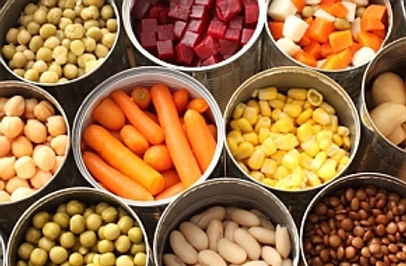 cans of vegetables with tops off