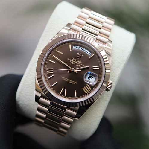 Unworn 18ct Rose Gold Rolex Oyster Perpetual Day-Date 40 Chocolate Roman Dial