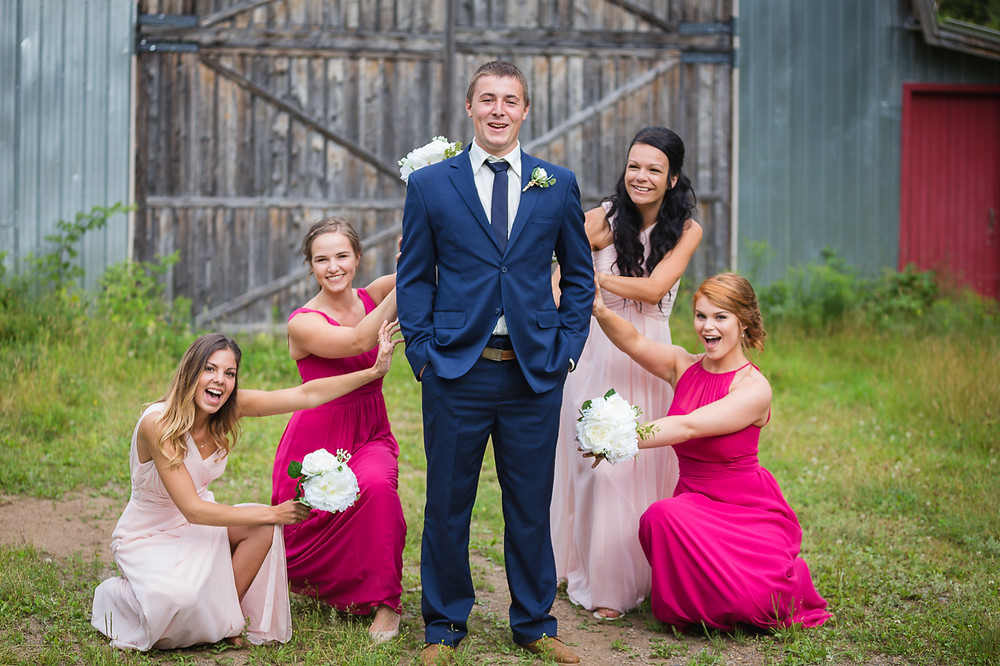 The groom is surrounded by beautiful bridesmaids