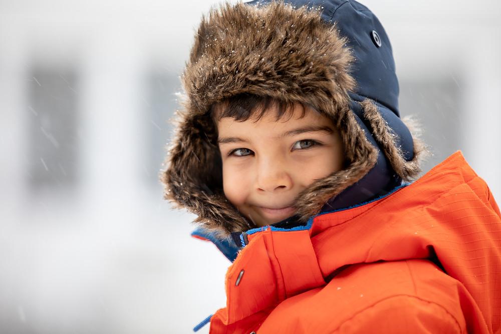 Portrait of a boy in winter gear outside.