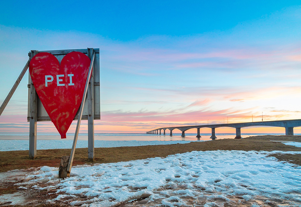 Late winter image of the Confederation Bridge, with a Love PEI sign
