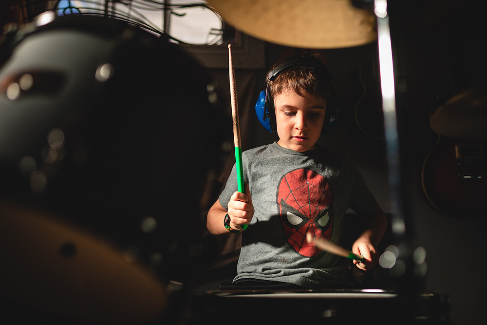 A boy playing drums