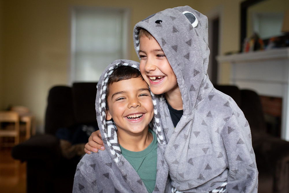 Brothers laughing and hugging