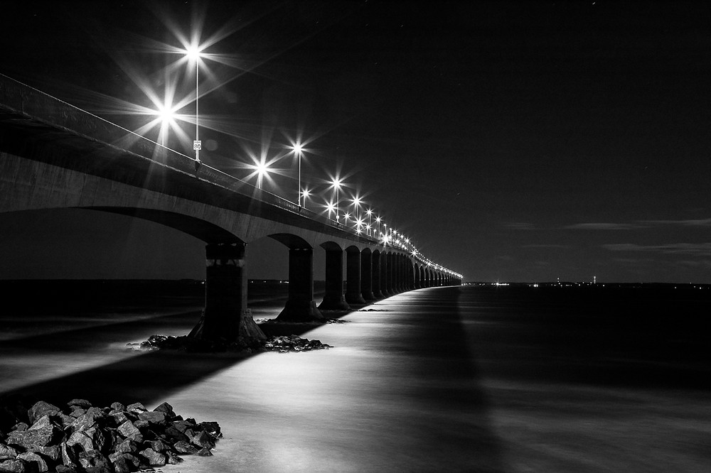 Black and white image of the Confederation Bridge at night
