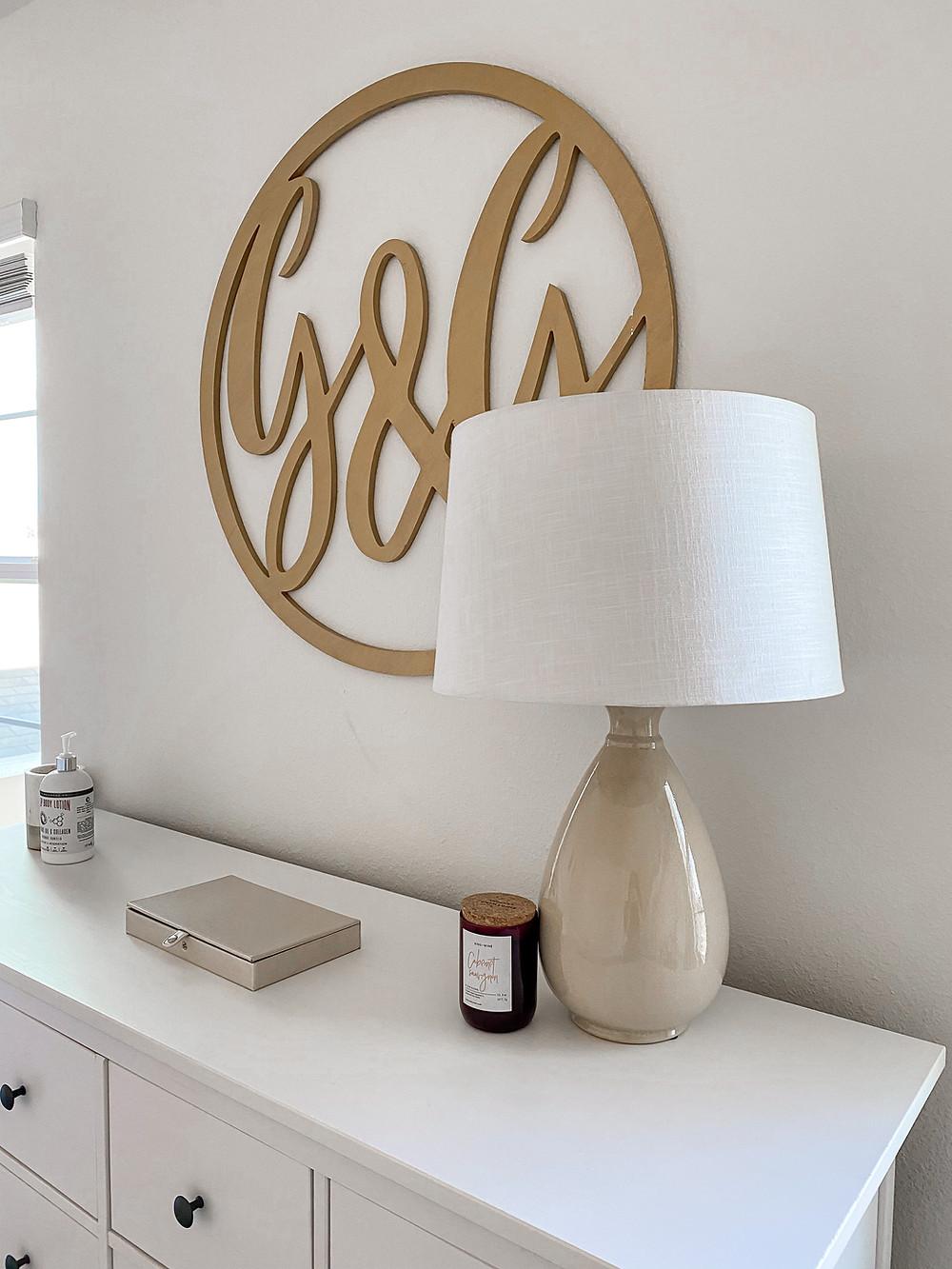 minimalist table lamp and signatura monogram wall art