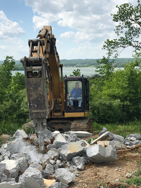 rockhammer busting old foundation.jpg