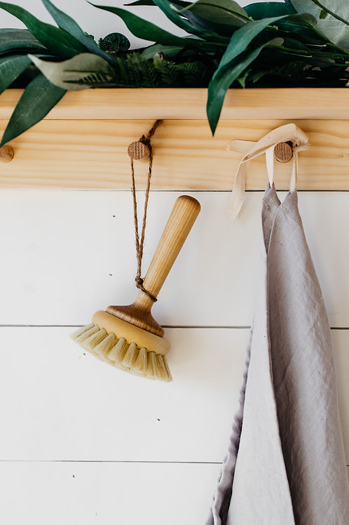 Wooden long-handled bathtub brush for sustainable home cleaning. Sold by Salt Creek Mercantile.