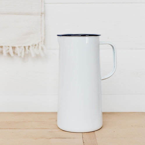 Falcon enamelware pitcher in white and blue. Displayed in modern farmhouse kitchen.