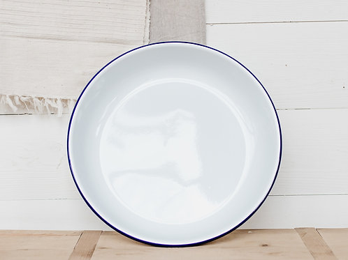 Falcon enamelware salad bowl in white and blue, displayed in a modern farmhouse kitchen.