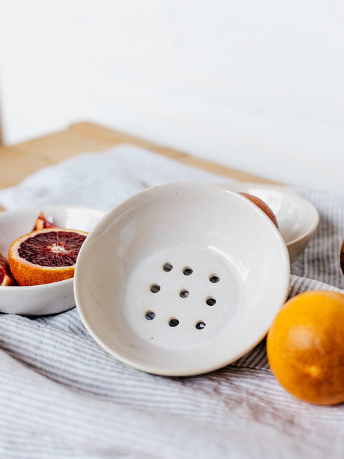 Ceramic dish with drain holes for rinsing fruits and veggies. Sold by Salt Creek Mercantile.