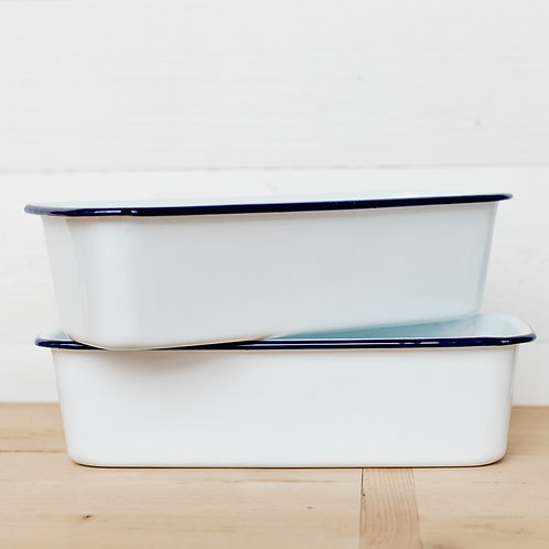 Stacked Falcon enamelware loaf pans in white and blue. Displayed in a modern farmhouse kitchen. Sold by Salt Creek Mercantile