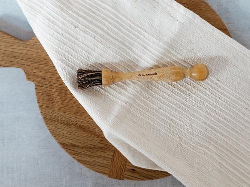 Handmade wooden mushroom brush from Iris Hantverk. Sold by Salt Creek Mercantile.