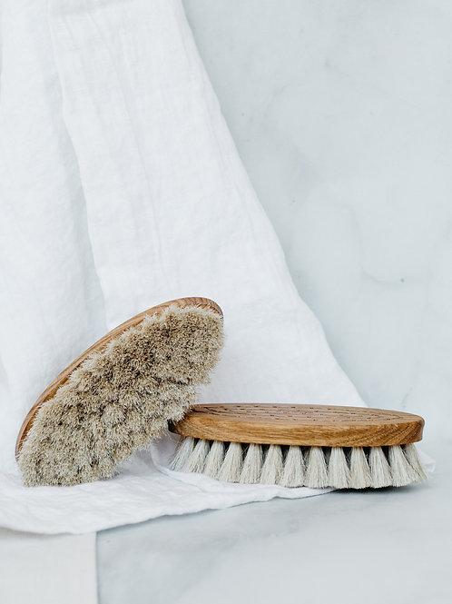 Handmade wooden oval bath brushes. Sold by Salt Creek Mercantile.