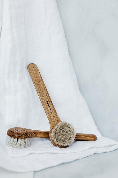 Handmade oak facial brushes. Sold by Salt Creek Mercantile.