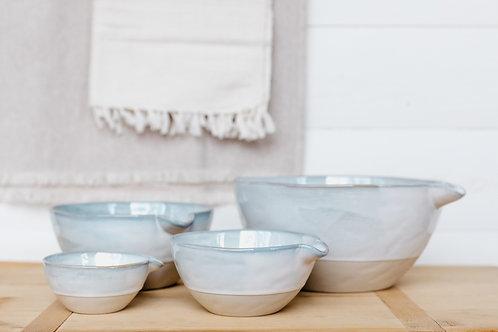 Set of 4 stoneware batter bowls with pour spouts in a modern farmhouse kitchen. Sold by Salt Creek Mercantile.