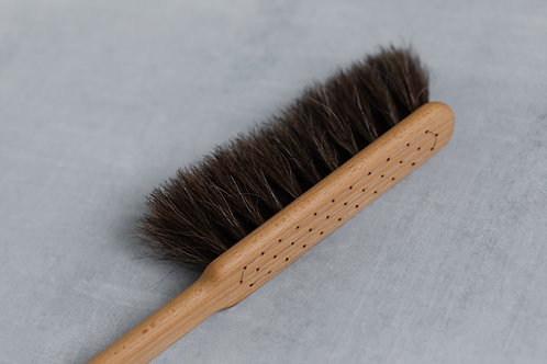 Handmade wooden bench broom for sustainable home cleaning. Sold by Salt Creek Mercantile.
