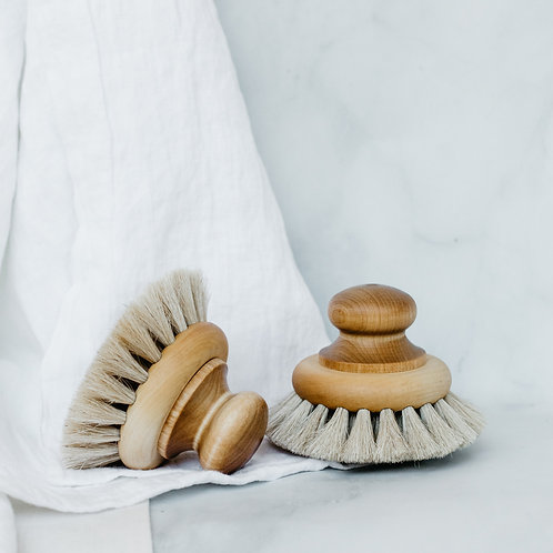 Two handmade round handle bath brushes. Sold by Salt Creek Mercantile.
