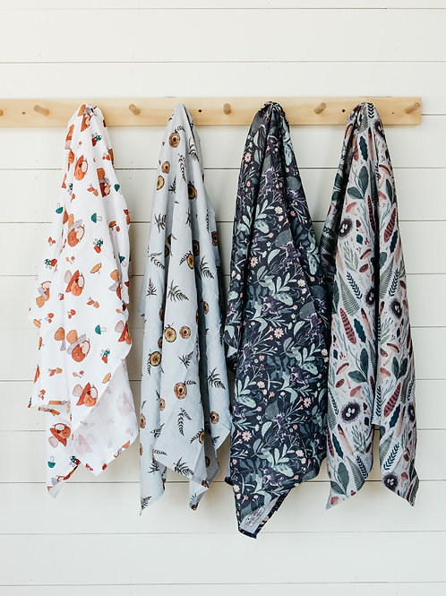 The Swaddle Co. organic swaddles hanging up at Salt Creek Mercantile.