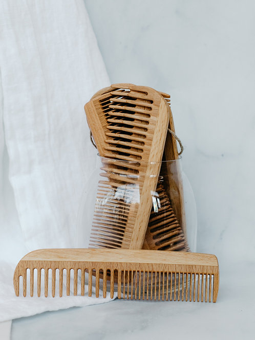 Wooden combs in glass jar. Sold by Salt Creek Mercantile.