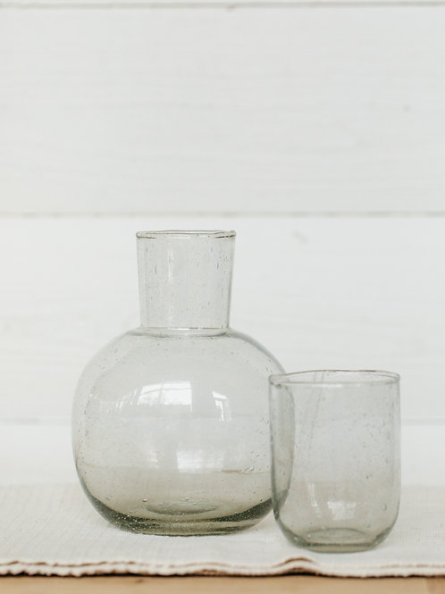 Seeded glass carafe with drinking glass. Sold by Salt Creek Mercantile.