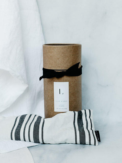 White and black stripe lavender eye pillow with cardboard package. Sold by S