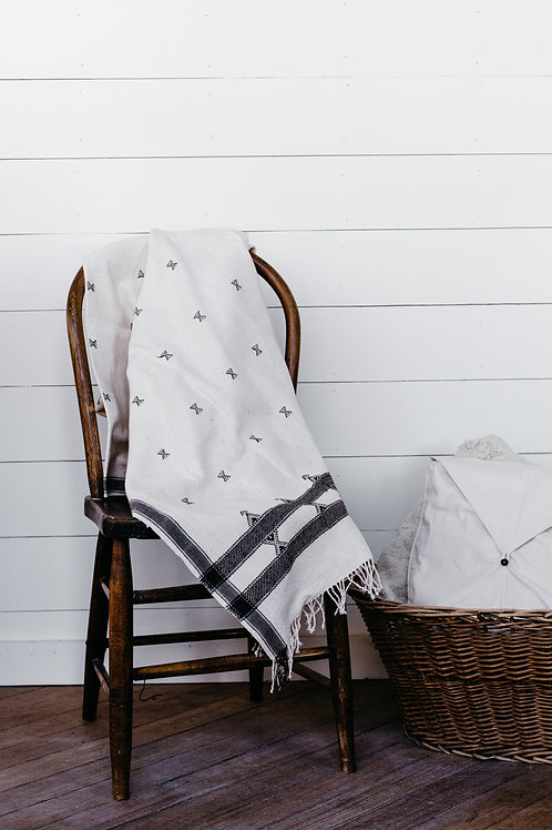 Soft blanket with a beautiful pattern and tassels. Sold by Salt Creek Mercantile.
