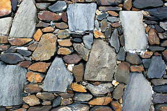 an-old-stone-wall-texture-with-rocks-of-
