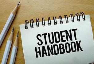 Student Handbook text written on a notebook with pencils.jpg