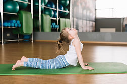 side-view-small-girl-practicing-yoga-hea