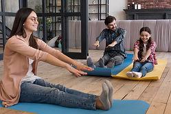 family-doing-yoga-sesion_23-2148542879.j