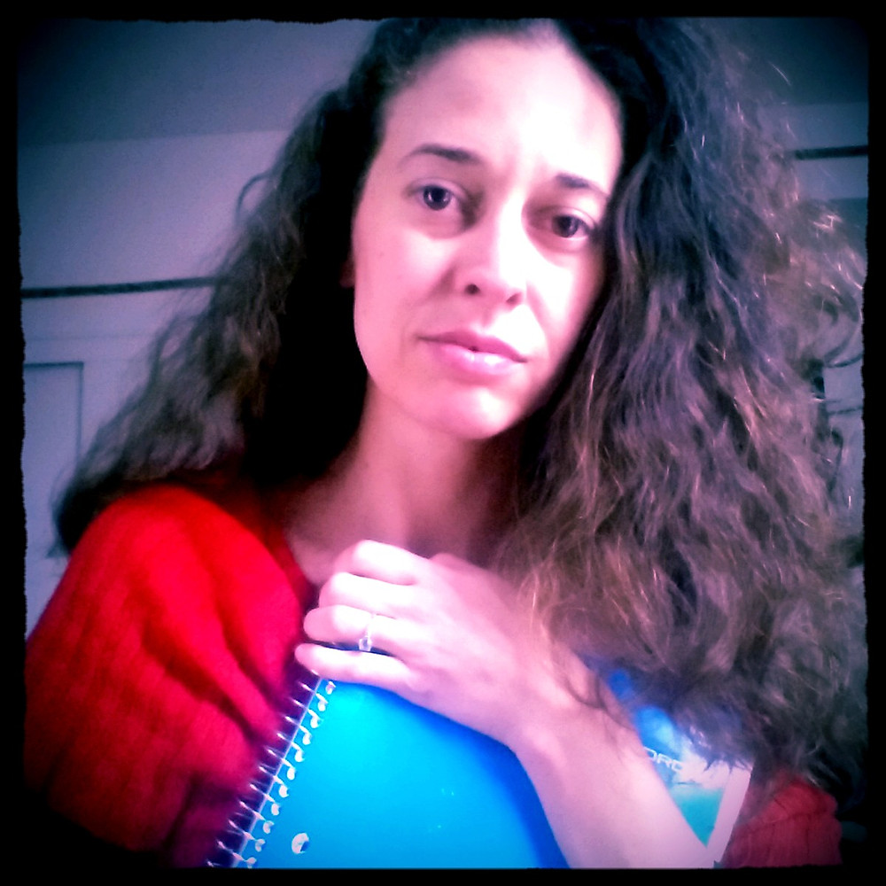 Woman holding blue notebook