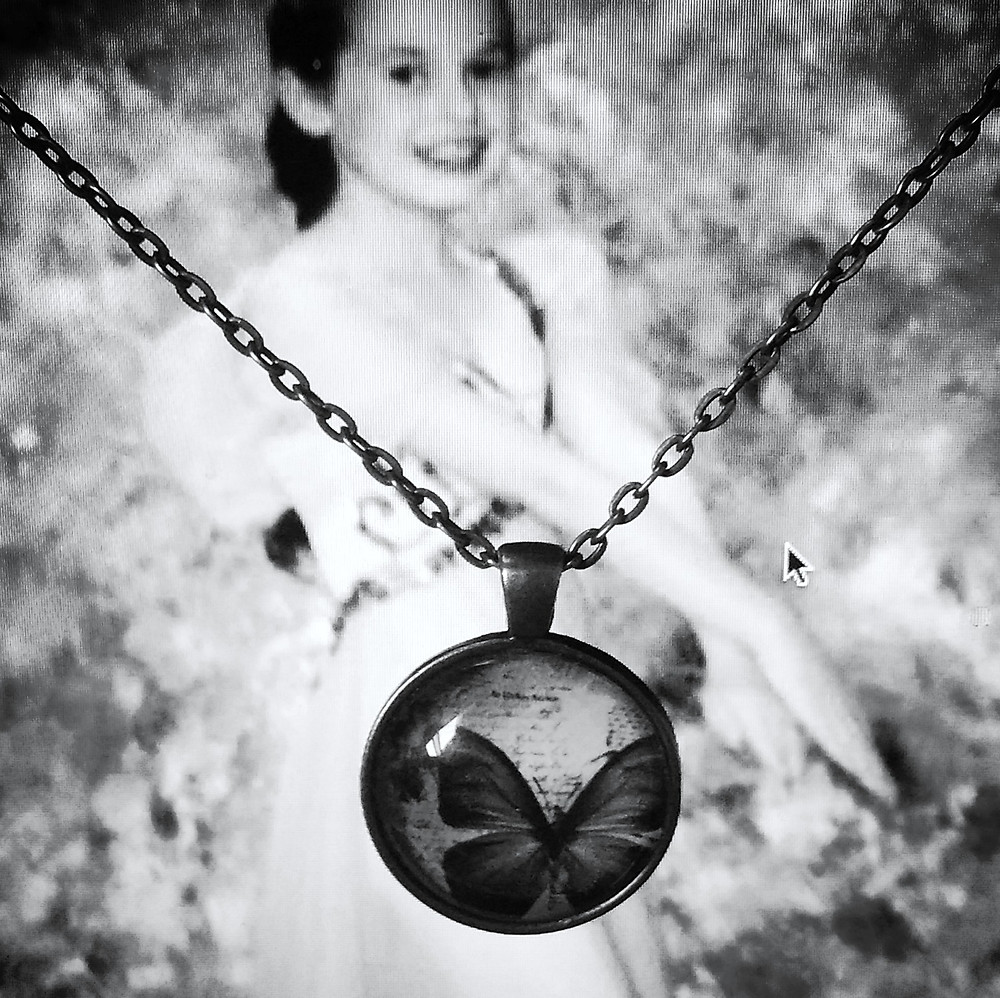 dance picture with butterfly pendant