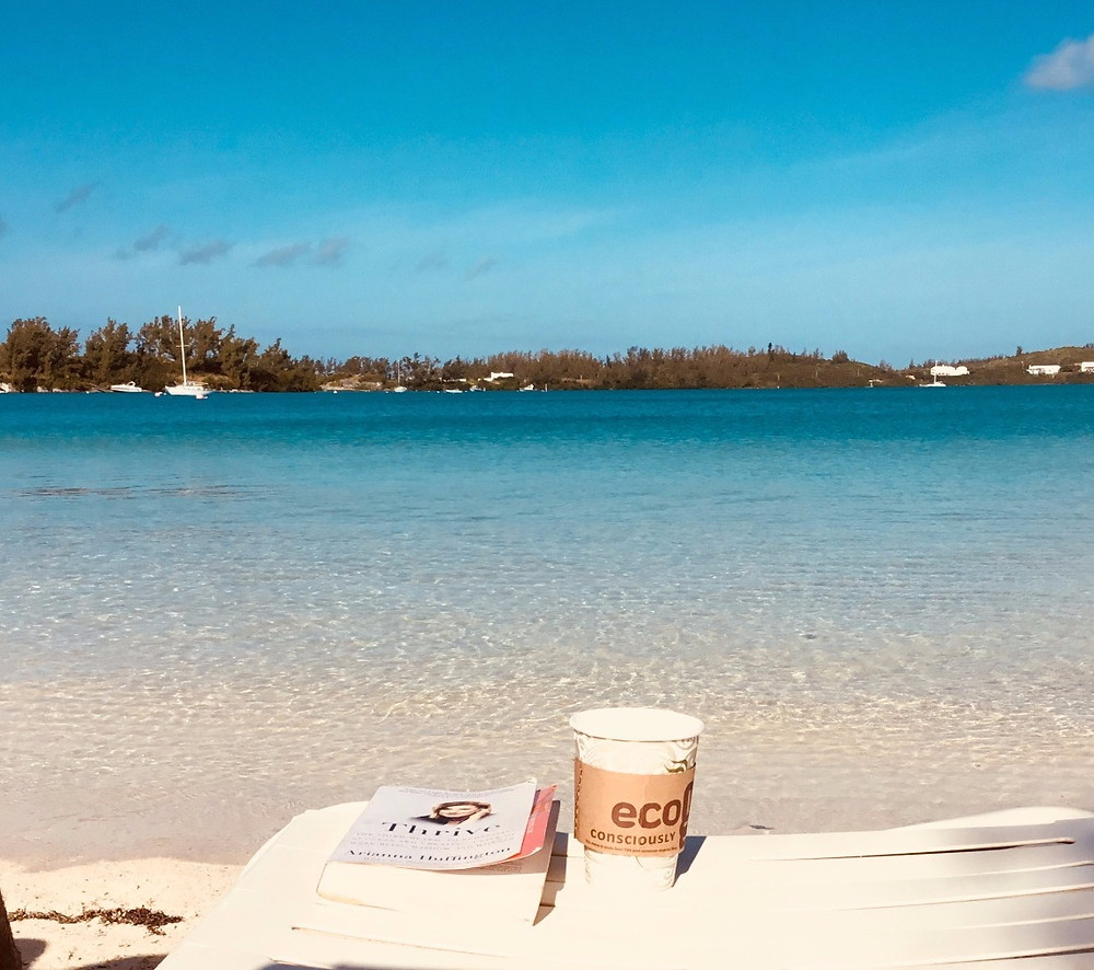 sitting on beach chair with coffee and book