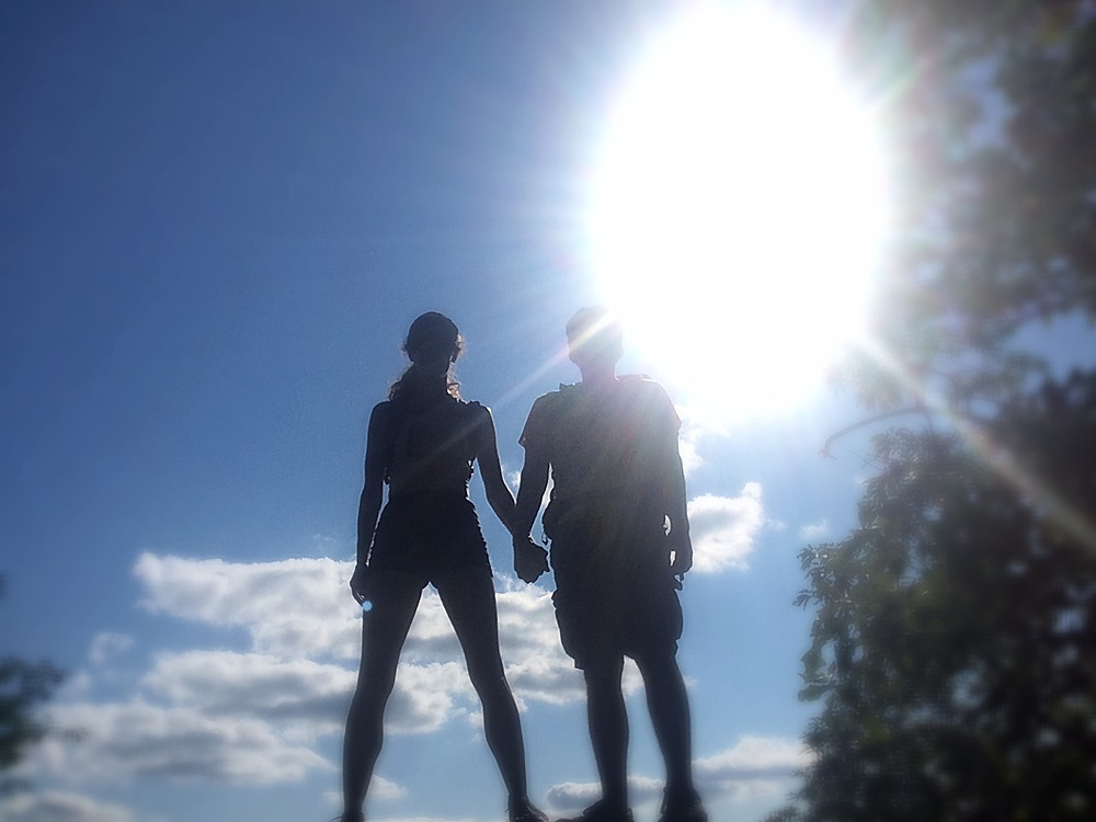 Sunny day Girl and guy holding hands