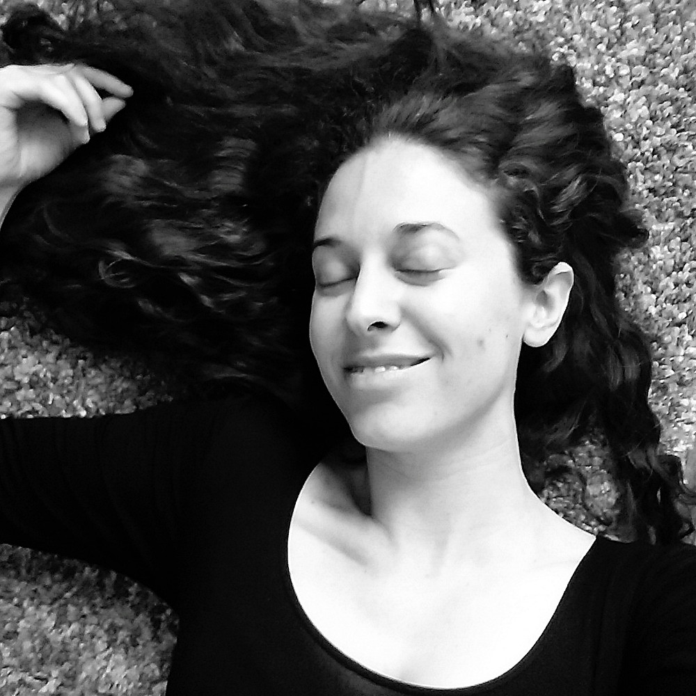 woman lying down on carpet with eyes closed
