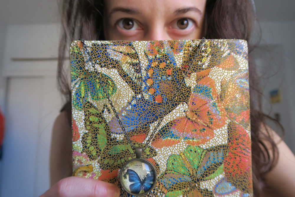 Woman with Butterfly journal with butterfly necklace