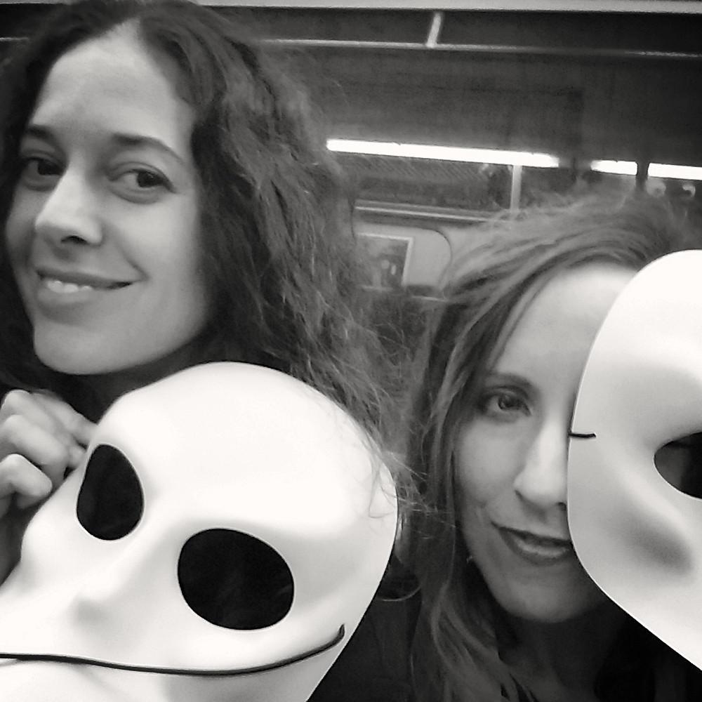 2 friends holding sleep no more masks on subway