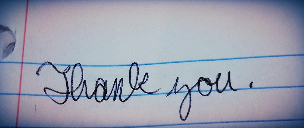 Thank you written in a notebook