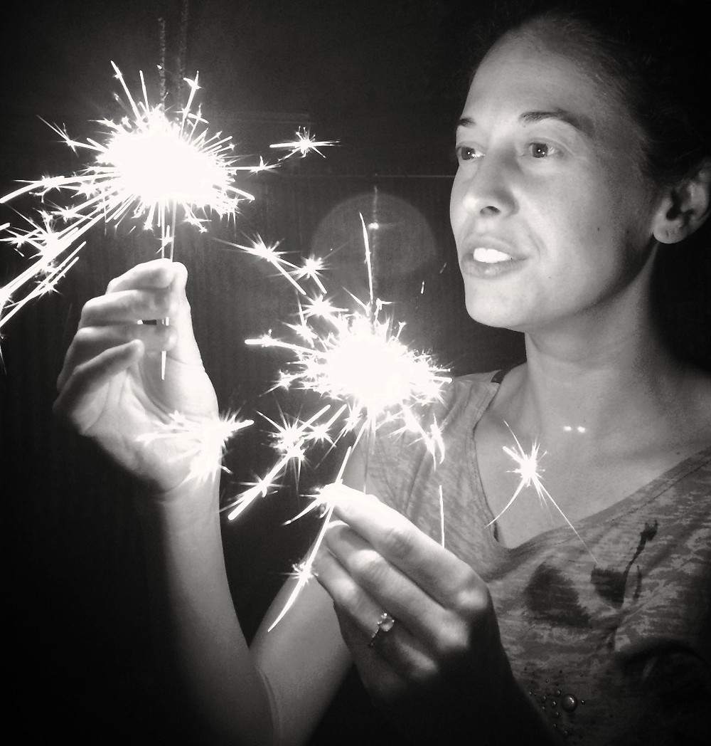 Woman with 2 sparklers
