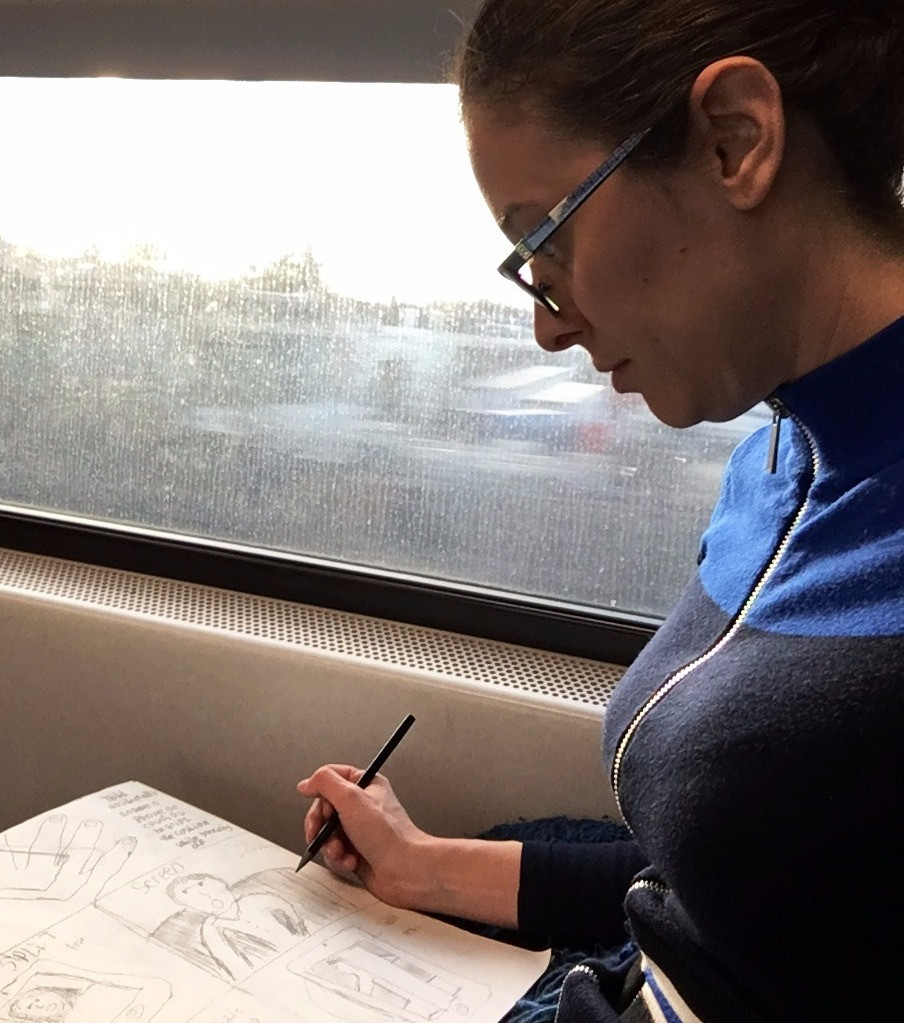 Women sketching on a train