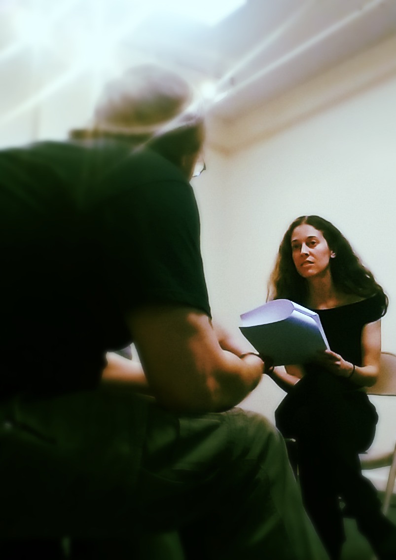 Woman looking at director with a script in her hand