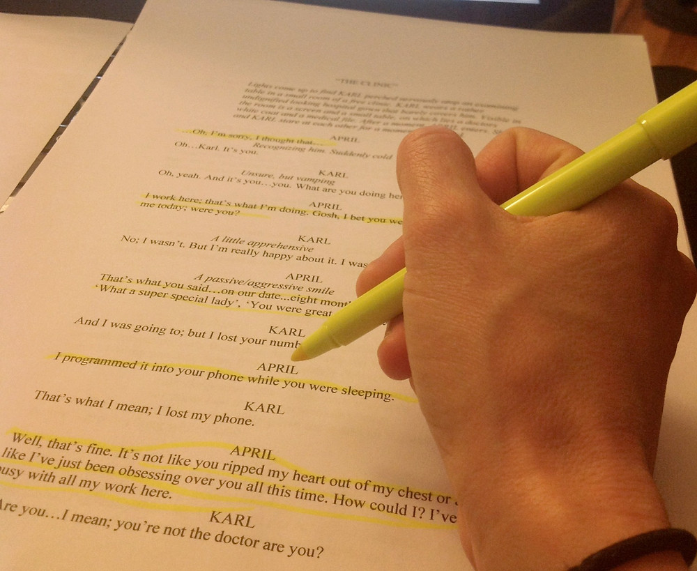 Girl highlighting lines from a script