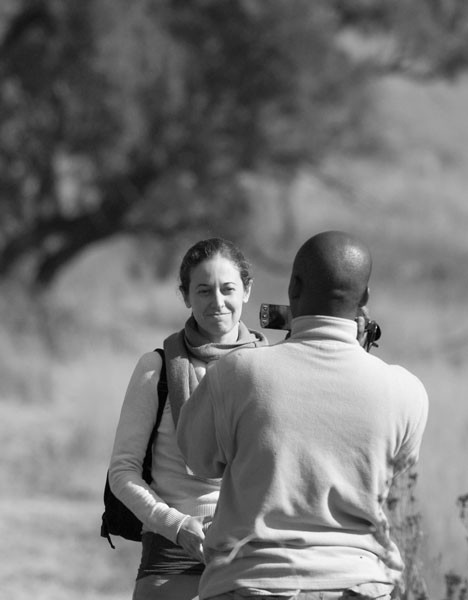 Woman being photographed by new found friend in South Africa