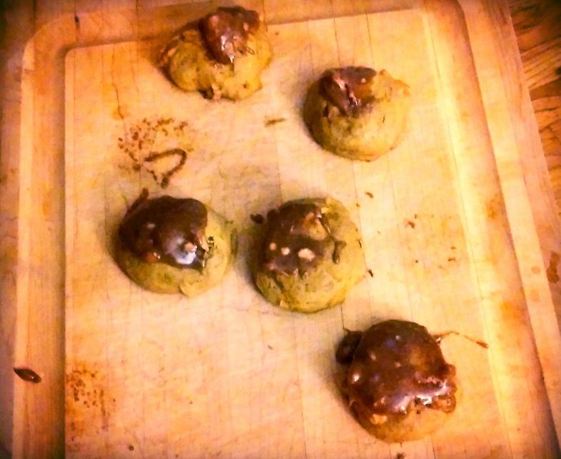 Pumpkin glazed cookies on cutting board