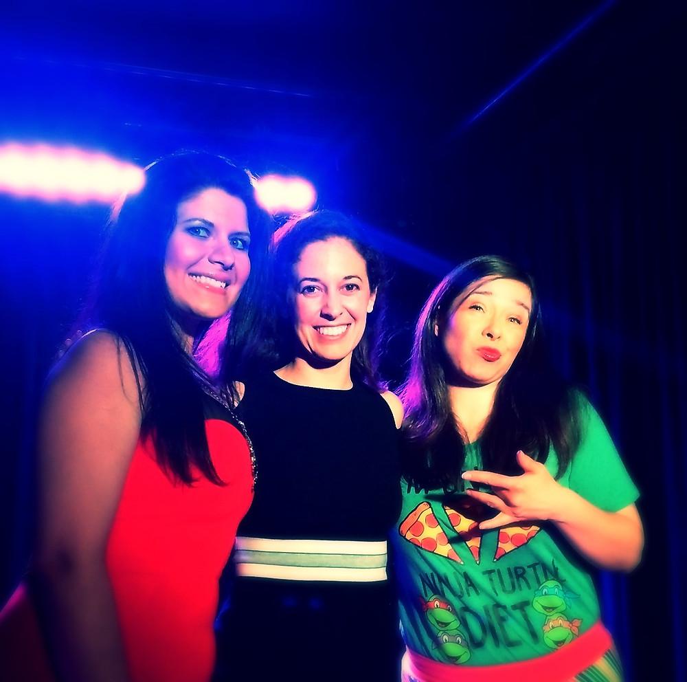 3 women posing on stage