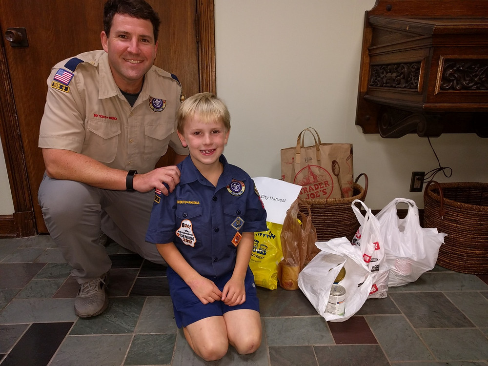 Cub Scouts delivering canned goods to #MBPCUSA Church