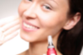 Patient smiling as she receives mesotherapy treatment