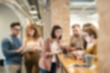 shallow-focus-photo-of-people-discussing
