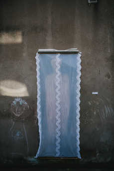 'In the Corner of My Eye' - raw clay painted on canvas with net curtain.  Anna Donovan.  Photo Credit; Neal Campbell
