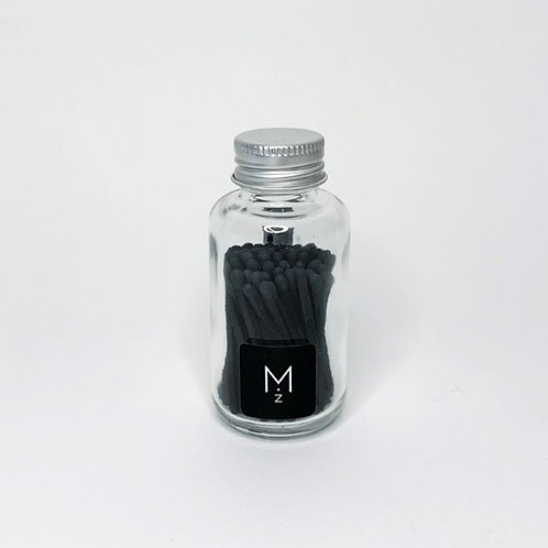 Black Tipped Matches Inside Glass Jar - Front View